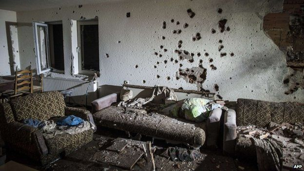 A bullet-riddled wall in a house following clashes between Macedonian police and an armed group in Kumanovo on 10 May 2015.