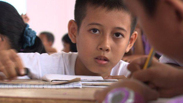 Mark Devilleres, aged 12, son of an immigrant in Malaysia