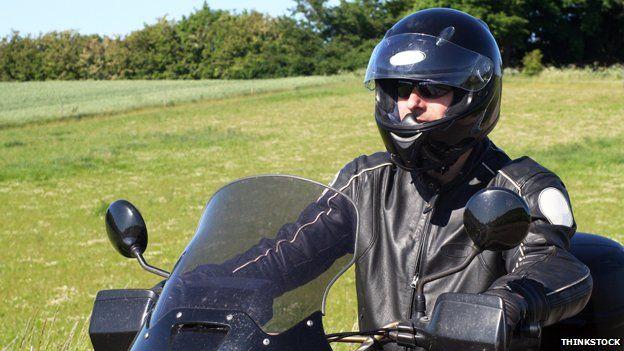 Motorcycle rider in black