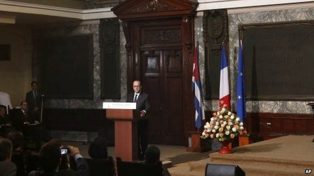 French President Francois Hollande answers a question from a student after giving a speech at Havana's University lecture hall, in Havana, Cuba, Monday, May 11, 2015