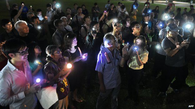 Supporters gather at the speaker's corner during a vigil for 16-year-old student Amos Yee who is in prison in Singapore on 11 May 2015