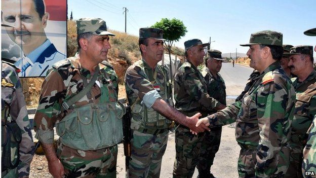 Syrian Defence Minister Fahd Jassem al-Freij (right) with troops near Damascus (06/05/15)
