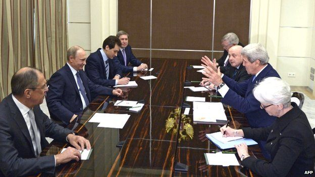 Russian President Vladimir Putin (second left) meets US Secretary of State John Kerry during their meeting at the Bocharov Ruchei residence in Sochi (12 May 2015)