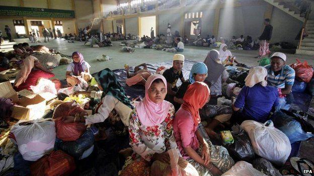 Rohingya refugees get some rest at Lhok Sukon Stadium, in Lhoksukon, Aceh, Indonesia, 13 May 2015.