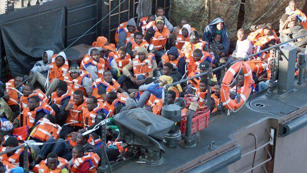 Migrants being taken to HMS Bulwark