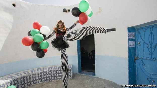 A performer on silts at the FiSahara in Dakhla camp, Algeria