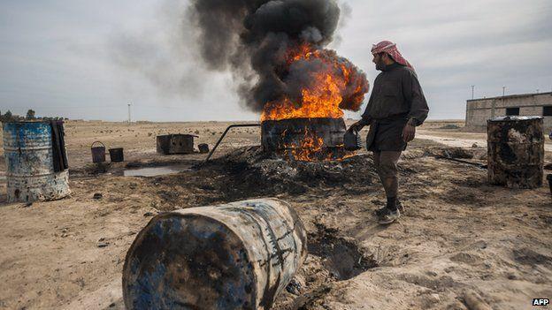 Archive photo of a farmer burning oil in Deir al-Zour province, Syria, 2013