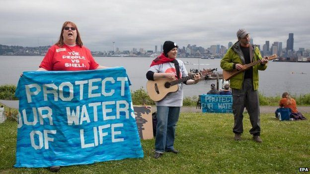 Activists sing songs during the protest in Seattle. Photo: 16 May 2015