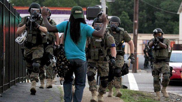 Protester faces police in Ferguson