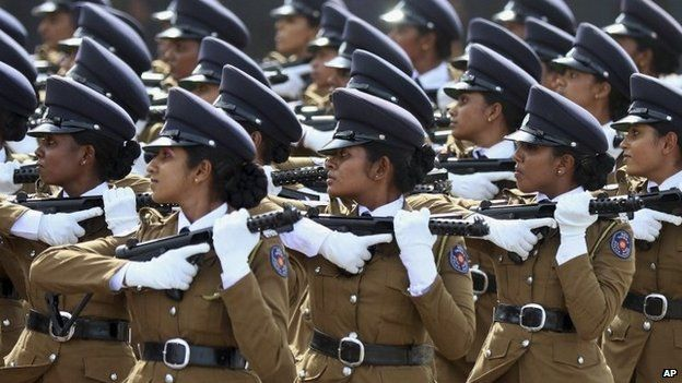 Sri Lankan women police officers march during a parade in Matara, about 165 kilometers (103 miles) south of Colombo, Sri Lanka, Tuesday, May 19, 2015.