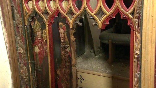 The damaged panels at Holy Trinity Church in Torbryan, Devon