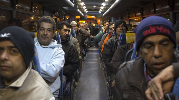 Palestinians sit in a bus as a new line is made available by Israel to take Palestinian labourers from the Israeli army crossing Eyal, near the West Bank town of Qalqilya, into the Israeli city Tel Aviv, 4 March 2013