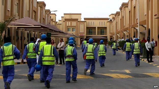 Foreign labourers working on the construction site of the al-Wakrah football stadium, one of the Qatar's 2022 World Cup stadiums, walk back to their accommodation at the Ezdan 40 compound after finishing work, 4 May 2015