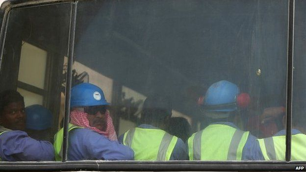 Migrant workers on a bus in Doha on 04 May, 2015