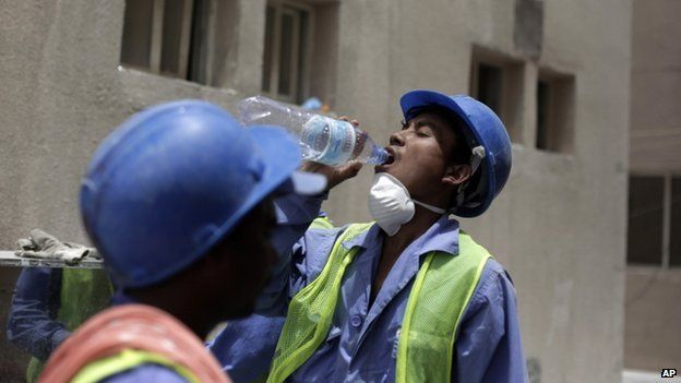 A migrant worker from Nepal takes a break on a building site in Doha, Qatar on 03 May, 2015