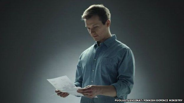 A still from the defence forces shows a reservist receiving a letter