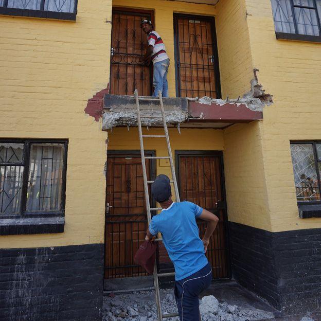 residents using stepladder