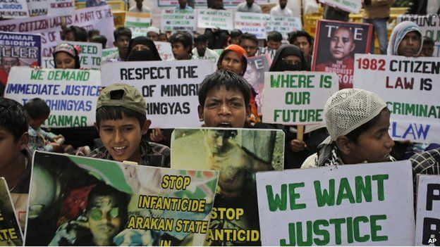 Rohingya refugees living in India hold placards during a protest demanding an end to the violence against ethnic Rohingyas in Myanmar
