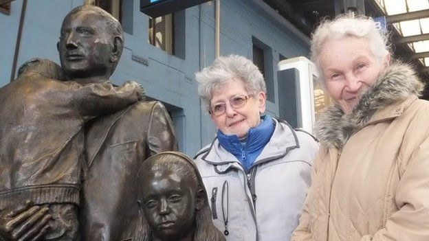 Milena Grenfell-Baines (left) and Ruth Halova next to the statue which commemorates Winton's efforts at Prague railway station