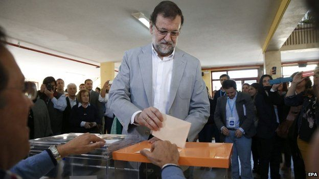 Spanish Prime Minister, Mariano Rajoy, casts his vote at a polling station in Aravaca, Madrid, Spain, 24 May 2015