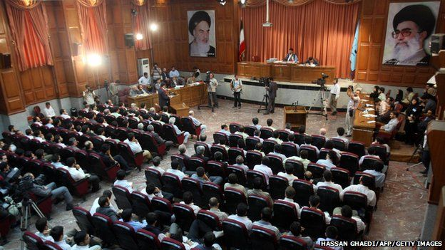 A general view of a courtroom shows suspected opposition supporters (in grey) attending the latest session in their trial at the revolutionary court in Tehran on 25 August 2009.