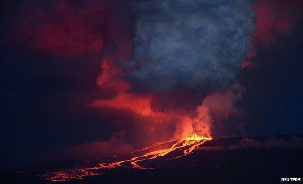 The Wolf volcano spews smoke and lava on Isabela Island, 25 May 2015