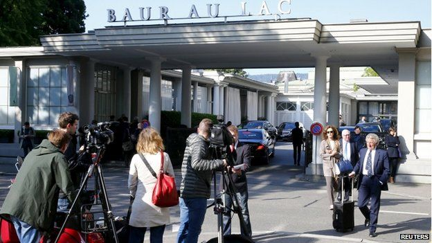 Members of the media stand outside the Baur au Lac hotel in Zurich, Switzerland, on 27 May 2015.