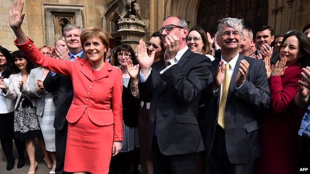 SNP MPs assemble outside the Houses of Parliament