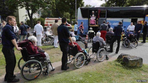 Disabled pensioners being moved to a nursing home
