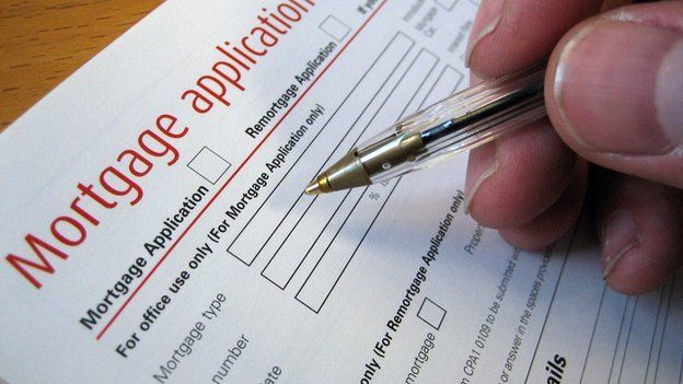 Man filling out mortgage application form