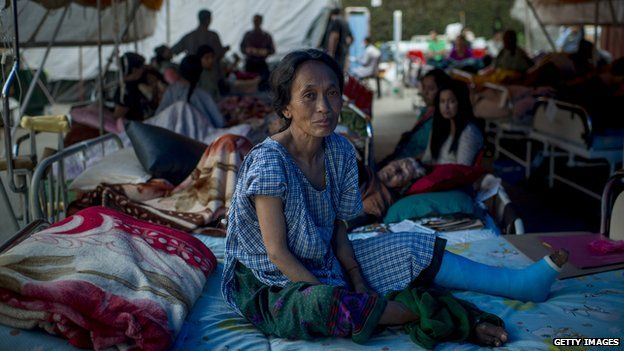 A woman in a makeshift camp after the recent earthquake in Nepal