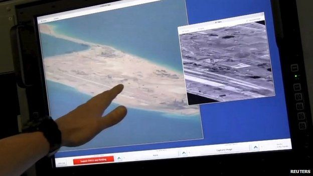 US Navy official with image showing purported Chinese construction activity