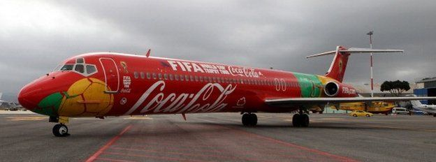 A jet emblazoned with Coca-Cola and Fifa logos