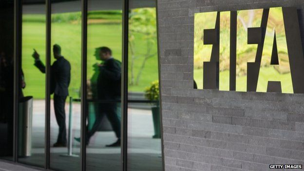 A Fifa logo sits next to the entrance to the organisation's headquarters on 27 May 2015 in Zurich, Switzerland