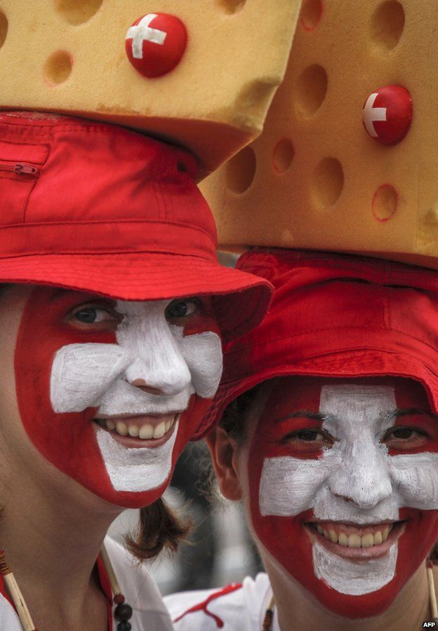Switzerland's fans wear Swiss cheese hats before entering the Amazonia Arena in Manaus, Brazil, before the start of the FIFA World Cup Group E football match between Honduras and Switzerland on June 25, 201