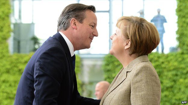 David Cameron and Angela Merkel greet each other in Berlin