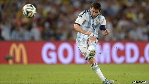 Lionel Messi in action for Argentina at the 2014 World Cup in front of a McDonald's advert