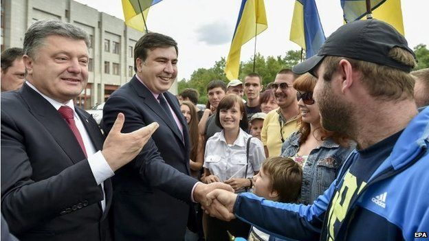 Ukrainian President Petro Poroshenko (left) presents Mikheil Saakashvili (centre) as new Odessa governor. Photo: 30 May 2015