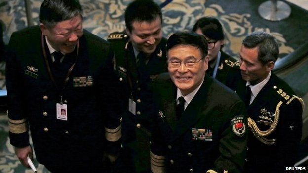 China's Admiral Sun Jianguo smiles as he arrives for a bilateral meeting ahead of the Shangri-La Dialogue in Singapore on 29 May 2015
