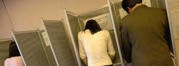 People casting a vote at an election