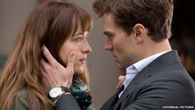Dakota Johnson (left) and Jamie Dornan in a scene from Fifty Shades of Grey