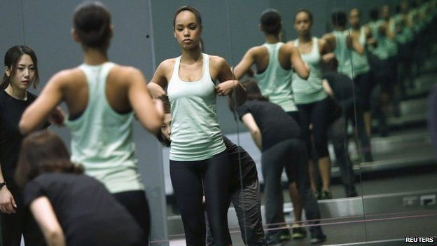 Miss Universe Japan Ariana Miyamoto is reflected on mirrors as she works out at a gym in Tokyo April 1, 2015