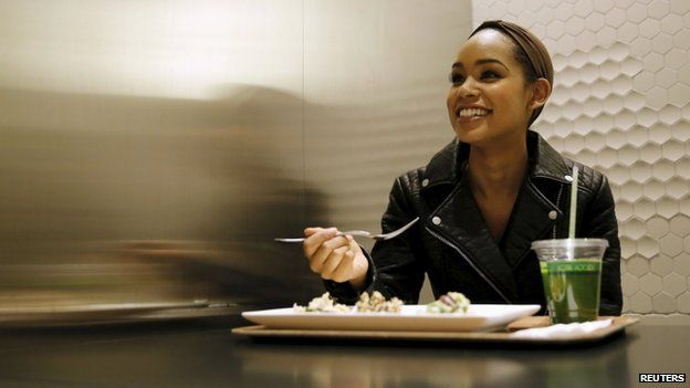 Miss Universe Japan Ariana Miyamoto lunches before her workout at a gym in Tokyo April 1, 2015