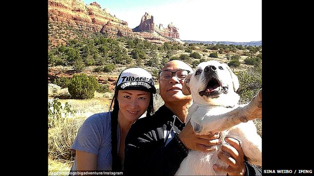 Chinese couple pose with their dog