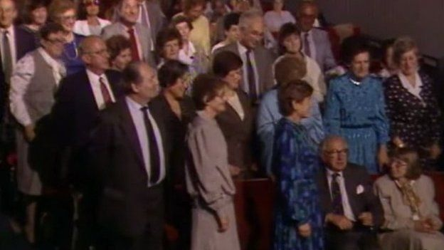 Sir Nicholas Winton (bottom right, sitting down) in 1988 on That's Life when some of the people he rescued were in the audience and surprised him