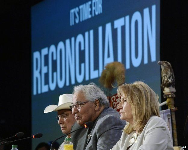 Commission chairman Justice Murray Sinclair (C) and fellow commissioners Marie Wilson (R) and Wilton Littlechild discuss the commissions report on Canada's residential school system at the Truth and Reconciliation Commission on 2 June.