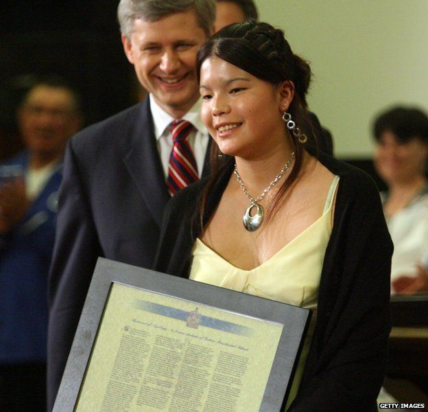 anadian Prime Minister Stephen Harper (L) smiles after presenting a framed statement of apology to Crystal Merasty, the youngest recipient of compensation, the Common Experience Payment, and a First Nations survivor of a residential school, on Parliament Hill June 11, 2008 in Ottawa, Canada.