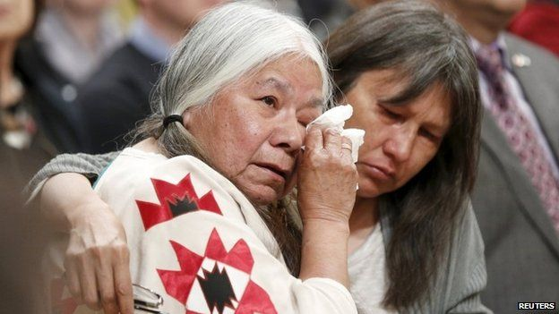Attendees embrace during the Truth and Reconciliation Commission of Canada closing ceremony at Rideau Hall in Ottawa 3 June 2015