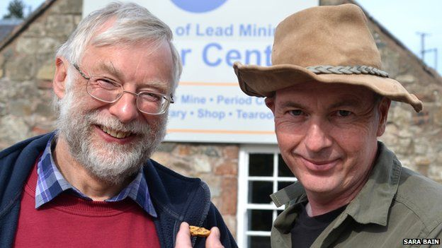 Wanlockhead Museum of Lead Mining Trustee Gerard Godfrey and gold panning expert Leon Kirk with the 18.1 golden nugget found in a burn close to Wanlockhead.