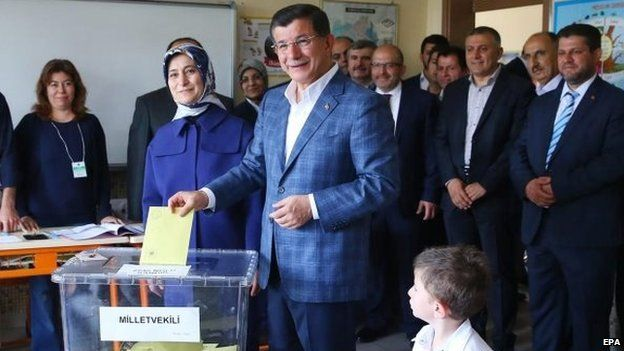 A handout picture provided by the Press Office of the Turkish Prime Minister shows Prime Minister Ahmet Davutoglu (C) casting his vote at a polling station in Konya, Turkey on 7 June 2015